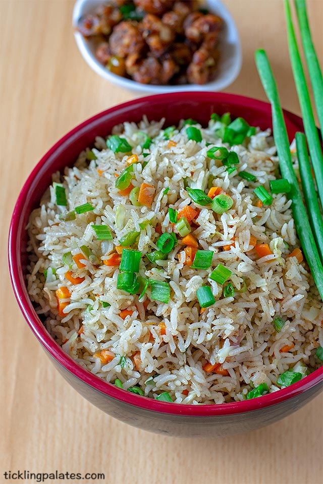 Veg fried rice recipe with video. Indo Chinese Vegetable Fried Rice is one of the most versatile and tastiest meal that can be make for a quick meal. It is also one of the most popular street food across India. Fried rice is most commonly served and enjoyed with Gobi Manchurian as side dish. Fried rice can be cooked in many ways and lots of varieties are made and served in almost all of the fast food joints. Other than fried rice, the next hot favorite would be this Chinese Veg Noodles. Why is fried rice most popular? Its because, takes minimal effort in making newbie friendly hard to mess up satiating & keeps you full you don't even need a recipe to make this What vegetables can I use? You can add any vegetable that basically gets cooked just by sautéing on a hot pan for few seconds. Avoid using vegetable that are high on water content as it will make the rice go mushy. You can use purple cabbage along with regular cabbage. coloured bell peppers along with capsicum to make the rice look more colourful. You can also add button mushrooms, oyster mushrooms, peas, mung bean sprouts etc while making fried rice. Just make sure that you cook the veggies on high heat not overcooking them while maintaining the crunch. What rice can I use? Basically you can use regular rice that you eat like boiled or raw rice to make fried rice. But since the recipe itself does not have any aroma inducing elements in it, I prefer using basmati rice for the fragrance it imparts. No matter whichever rice one may use, if the rice is a day old then fried rice tastes better. So making fried rice is one of the best way to put left over rice, if you have on hand to best use. How important is adding Sichuan Pepper? All recipes evolve when they cross geographical borders as people try to adapt & embrace it based on their needs, availability and affordability of the ingredients. Having said that, while adding Sichuan pepper will significantly lend the original taste to the fried rice, it can easily be replaced with regular black pepper that is available in our own pantry. Points to note while making fried rice: If possible always use pre cooked rice that has been refrigerated and thawed to room temperature that is at least 1 day old. The result is the best tasting fried rice. The condiments you use can all be adjusted according to your taste. Make sure you have the veggies & the condiments near you, all ready to be added before you start making the fried rice. Instead of black pepper you can also add white pepper powder but it will be a bit less spicy. Adding Aji-no-moto or the chinese salt is optional and a personal preference.